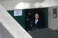 (FILES) In this file photo taken on May 06, 2013 Beate Zschaepe (C) leaves the regional courthouse in Munich, southern Germany, after the first day of her trial.   One of the biggest trials in modern German history will end on July 11, 2018 when the court will hand a verdict to Beate Zschaepe, the only surviving member of a neo-Nazi cell behind a string of racist murders. Zschaepe, 43, is accused of complicity in 10 deadly shootings of mostly Turkish and Greek-born immigrants carried out by clandestine trio the National Socialist Underground (NSU). / AFP PHOTO / Christof STACHE