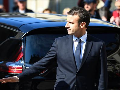 French president-elect Emmanuel Macron gestures as he leaves leaves Saint-Jean-du-Baly church after the funeral ceremony of French socialist lawmaker Corinne Erhel in Lannion, western France, on May 10, 2017. Corinne Erhel, 50, died on May 5, 2017, after she spoke during a campaign meeting for French presidential election candidate for the En Marche ! movement Emmanuel Macron. / AFP PHOTO / Damien MEYER