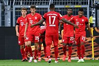 Bayern Munich's German midfielder Joshua Kimmich (L) celebrates scoring with his team-mates during the German first division Bundesliga football match BVB Borussia Dortmund v FC Bayern Munich on May 26, 2020 in Dortmund, western Germany. (Photo by Federico GAMBARINI / POOL / AFP) / DFL REGULATIONS PROHIBIT ANY USE OF PHOTOGRAPHS AS IMAGE SEQUENCES AND/OR QUASI-VIDEO