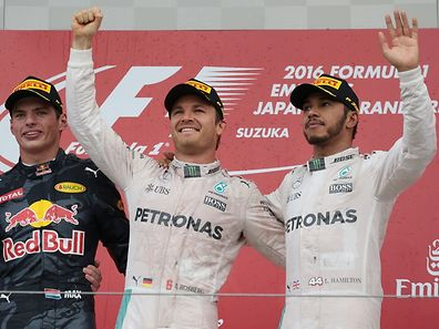 Mercedes AMG Petronas F1 Team's German driver Nico Rosberg (C) celebrates his victory on the podium next to second-placed Red Bull Racing's Belgian-Dutch driver Max Verstappen (L) and third-placed Mercedes AMG Petronas F1 Team's British driver Lewis Hamilton (R)