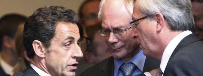 Nicolas Sarkozy und Jean-Claude Juncker zusammen mit dem neuen EU-Ratspräsident Herman Van Rompuy (Mitte).