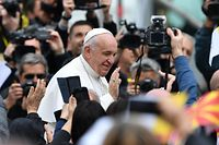 Pope Francis greets worshippers from the popemobile as he arrives to lead a Holy Mass on Macedonia square in Skopje on May 7, 2019. - Pope Francis landed in North Macedonia in a visit delighting a small country whose capital is the proud birthplace of Mother Teresa. People of all faiths have been scooping up the 15,000 tickets to attend the Pope's mass in Skopje's main square, which will be held just down the street from where Mother Teresa was baptised in 1910. Ahead of his visit, Francis praised the mix of cultures, religions and ethnicities in a country that sits at the cross-roads of the East and West. (Photo by Dimitar DILKOFF / AFP)