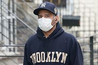 A man wearing a mask walks through the Bushwick section of Brooklyn April 5, 2020 in New York. - The coronavirus death toll in New York state spiked to 4,159, the governor said, up from 3,565 a day prior. The toll increase of 594 showed a slight decrease in the day-to-day number of lives lost compared to the previous day.  Governor Andrew Cuomo told journalists it was too soon to tell whether the decrease from the previous record of 630 deaths in one day was statisically significant. (Photo by Bryan R. Smith / AFP)