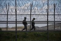 (FILES) This file photo taken on April 23, 2020 shows South Korean soldiers patrolling along a barbed wire fence Demilitarized Zone (DMZ) separating North and South Korea, on the South Korean island of Ganghwa. - North Korean troops fired multiple gunshots towards the South in the Demilitarized Zone dividing the peninsula on May 3, 2020, prompting South Korean forces to fire back, Seoul said. (Photo by Ed JONES / AFP)