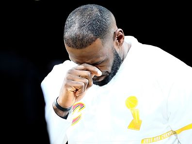 CLEVELAND, OH - OCTOBER 25: LeBron James #23 of the Cleveland Cavaliers reacts during the championship banner raising and ring ceremony before the game against the New York Knicks at Quicken Loans Arena on October 25, 2016 in Cleveland, Ohio.   Ezra Shaw/Getty Images/AFP == FOR NEWSPAPERS, INTERNET, TELCOS & TELEVISION USE ONLY ==