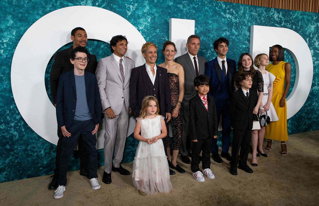 """(L-R) Luca Faustino Rodriguez, Aaron Pierce, M. Night Shyamalan, Kylie Begley, Gael Garc�a Bernal, Vicky Krieps, Rufus Sewell, Kailen Jude, Alex Wolff, Nolan River, Alexa Swinton, Mikaya Kenzie Fisher and Nikki Amuka-Bird attend the New York premiere of """"Old"""" at Jazz at Lincoln Center on July 19, 2021 in New York City. (Photo by Kena Betancur / AFP)"""