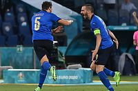 Italy's midfielder Manuel Locatelli (C) celebrates with Italy's defender Leonardo Bonucci (R) after scoring the second goal during the UEFA EURO 2020 Group A football match between Italy and Switzerland at the Olympic Stadium in Rome on June 16, 2021. (Photo by ANDREAS SOLARO / POOL / AFP)