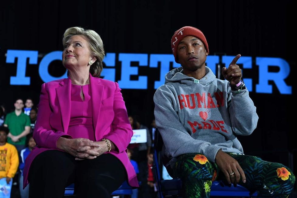 US Democratic presidential nominee Hillary Clinton and singer Pharrell Williams attend a campaign rally in Raleigh, North Carolina