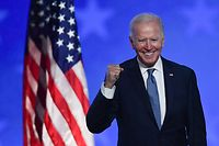 (FILES) In this file photo taken early on November 4, 2020 Democratic presidential nominee Joe Biden gestures after speaking during election night at the Chase Center in Wilmington, Delaware. - Joe Biden has won the US presidency over Donald Trump, TV networks projected on November 7, 2020, a victory sealed after the Democrat claimed several key battleground states won by the Republican incumbent in 2016. CNN, NBC News and CBS News called the race in his favor, after projecting he had won the decisive state of Pennsylvania. His running mate, US Senator Kamala Harris, has become the first woman US Vice President elected to the office. (Photo by ANGELA  WEISS / AFP)