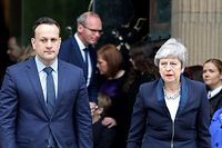 Irish Prime minister Leo Varadkar (L) and Britain's Prime Minister Theresa May leave St Anne's Cathedral in Belfast on April 24, 2019, after attending the funeral service of journalist Lyra McKee who was killed by a dissident republican paramilitary in Northern Ireland on April 18. - Lyra McKee, 29, who chronicled the troubled history of Northern Ireland, was shot in the head on April 18, 2019, as rioters clashed with police in Londonderry, the second city of the British province. (Photo by Paul Faith / AFP)