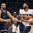 (FILES) In this file photo taken on January 7, 2019 Anthony Davis #23 of the New Orleans Pelicans drives the ball around Marc Gasol #33 of the Memphis Grizzlies at Smoothie King Center in New Orleans, Louisiana. - Marc Gasol and Markelle Fultz were reported to be on the move on February 7, 2019 as the NBA's trade deadline expired with no deal for New Orleans Pelicans star Anthony Davis. Memphis Grizzlies star Gasol was reportedly headed for the Toronto Raptors in exchange for Jonas Valanciunas, Delon Wright, CJ Miles and a 2024 draft pick, ESPN reported. (Photo by Chris Graythen / GETTY IMAGES NORTH AMERICA / AFP)