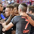 Bayern Munich's midfielder Joshua Kimmich (2nd L) celebrates scoring with his teammates during the German first division Bundesliga football match between Hamburg SV and FC Bayern Munich in Hamburg, northern Germany, on September 24, 2016. / AFP PHOTO / John MACDOUGALL / RESTRICTIONS: DURING MATCH TIME: DFL RULES TO LIMIT THE ONLINE USAGE TO 15 PICTURES PER MATCH AND FORBID IMAGE SEQUENCES TO SIMULATE VIDEO. == RESTRICTED TO EDITORIAL USE == FOR FURTHER QUERIES PLEASE CONTACT DFL DIRECTLY AT + 49 69 650050