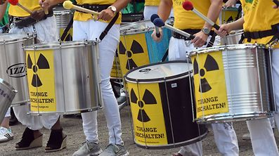 "CORRECTION - Participants of the anti-nuclear ""Chain Reaction"" demonstration beat the drums to protest against the operation of Belgium's Tihange 2 and the Netherland's Doel 3 nuclear power plants on June 25, 2017 in Aachen, western Germany, close to the border with Belgium and the Netherlands. / AFP PHOTO / dpa / Henning Kaiser / Germany OUT / �The erroneous mention appearing in the metadata of this photo by Henning Kaiser has been modified in AFP systems in the following manner: [Tihange] instead of [Thihange]. Please immediately remove the erroneous mentios from all your online services and delete it from your servers. If you have been authorized by AFP to distribute it to third parties, please ensure that the same actions are carried out by them. Failure to promptly comply with these instructions will entail liability on your part for any continued or post notification usage. Therefore we thank you very much for all your attention and prompt action. We are sorry for the inconvenience this notification may cause and remain at your disposal for any further information you may require.�"