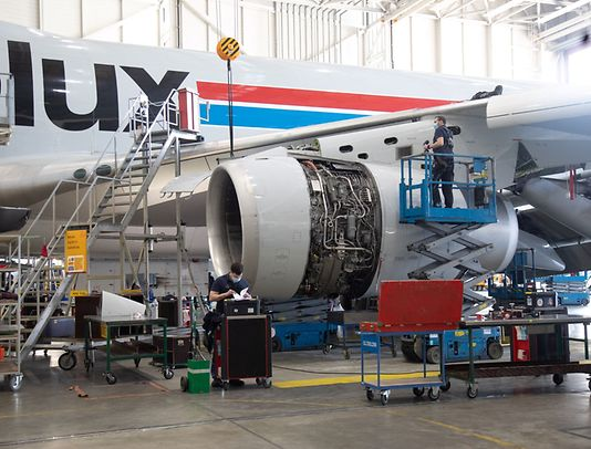 Maintenance crews work on the engine of a Cargolux jet at the company's Luxembourg hangar in February.