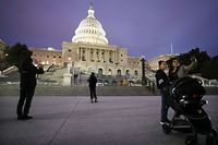 WASHINGTON, DC - JANUARY 26: People take photos in front of the U.S. Capitol on January 26, 2020 in Washington, DC. The defense team will continue its arguments tomorrow in the Senate impeachment trial against President Donald Trump.   Mario Tama/Getty Images/AFP == FOR NEWSPAPERS, INTERNET, TELCOS & TELEVISION USE ONLY ==