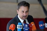 Luxembourg's Prime Minister Xavier Bettel speaks to medias as he arrives for an EU summit at the Europa building in Brussels, on June 21, 2019. - European leaders early on June 21, 2019 failed to agree on a new top team to lead efforts to reform their union for 2019-2024, and postponed a decision until the end of June. (Photo by Aris Oikonomou / AFP)