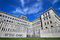 The World Trade Organization (WTO) headquarters are seen in Geneva on April 12, 2018. The World Trade Organization is set to release its latest forecasts as trade tensions between the United States and China ratchet up. / AFP PHOTO / Fabrice COFFRINI