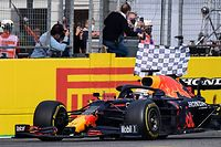 Winner Red Bull's Dutch driver Max Verstappen crosses the finish line during the Emilia Romagna Formula One Grand Prix at the Autodromo Internazionale Enzo e Dino Ferrari race track in Imola, Italy, on April 18, 2021. (Photo by Miguel MEDINA / AFP)