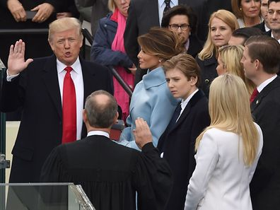 Donald Trump (L) is sworn in as the 45th US president by Supreme Court Chief Justice John Roberts in front of the Capitol in Washington on January 20, 2017.  / AFP PHOTO / Timothy A. CLARY