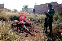 A soldier secures the area where a clandestine mass grave was discovered at Lomas del Vergel in the community of Zapopan, Jalisco state, Mexico, on January 16, 2020. - Nearly 2,500 murders were reported between January and November in Jalisco --  a state hard-hit by violence linked to organized crime -- state authorities have said. (Photo by Ulises Ruiz / AFP)