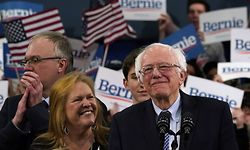 Democratic presidential hopeful Vermont Senator Bernie Sanders stands with wife Jane O'Meara Sanders at a Primary Night event at the SNHU Field House in Manchester, New Hampshire on February 11, 2020. - Bernie Sanders won New Hampshire's crucial Democratic primary, beating moderate rivals Pete Buttigieg and Amy Klobuchar in the race to challenge President Donald Trump for the White House, US networks projected. (Photo by TIMOTHY A. CLARY / AFP)