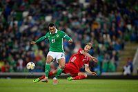 Northern Ireland V Luxembourg International challenge match at the National Football stadium in Belfast.  Lars Gerson of Luxembourg and  Josh Magennis of Northern Ireland during tonights game.  Picture Mark Marlow/AFP (Photo by AFP)