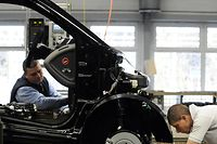 Employees work on the assembly line of the Smart ForTwo car at the Smart factory of Hambach, eastern France, on December 11, 2012. The third-generation Smart electric drive is scheduled to be launched in the U.S. and Europe by the second quarter of 2013 and Smart plans to mass produce the electric car with availability in 30 markets worldwide.  AFP PHOTO / JEAN-CHRISTOPHE VERHAEGEN