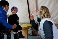 Katrin Glatz-Brubakk, mental health activity supervisor, playing with children in the waiting area of the MSF Clinic in Lesbos.