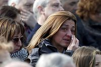A woman cries during a commemorative ceremony for victims of Germanwings Flight 9525 a day ahead of the first anniversary of the air crash, at Barcelona's airport, Spain, March 23, 2016. REUTERS/Albert Gea      TPX IMAGES OF THE DAY
