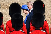 """Britain's Queen Elizabeth II (L) and US President Donald Trump (R) inspect the guard of honour formed of the Coldstream Guards during a welcome ceremony at Windsor Castle in Windsor, west of London, on July 13, 2018 on the second day of Trump's UK visit. US President Donald Trump launched an extraordinary attack on Prime Minister Theresa May's Brexit strategy, plunging the transatlantic """"special relationship"""" to a new low as they prepared to meet Friday on the second day of his tumultuous trip to Britain. / AFP PHOTO / POOL / Ben STANSALL"""