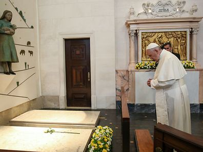 Pope Francis prays on the grave of Francisco Marto and Jacinta, two of the to three shepherd children, at Our Lady Rosario Cathedral at Fatima Sanctuary, Leiria, Portugal, 13 May 2017. Pope Francis is in visiting Fatima on 12 and 13 May on the 100th anniversary of the appearances of Mary. PAULO CUNHA/POOL/LUSA