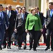 German Chancellor Angela Merkel (2nd,R) speaks with Romania's President Klaus Iohannis (R) as they and Slovenia's Prime Minister Marjan Sarec (L), Bulgaria's Prime Minister Boyko Borisov (2nd,L) and Cyprus' President Nicos Anastasiades arrive to take part in a family photo session prior to meeting at a EU summit in Sibiu, central Romania on May 9, 2019. (Photo by Daniel MIHAILESCU / AFP)
