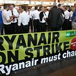 Belgium-based Ryanair pilots gather at Charleroi Airport in Gosselies on August 10, 2018, as they take part in a European wide strike. - Ryanair is bracing for mass travel disruptions as pilots across Europe begin a coordinated 24-hour strike to push their demands for better pay and conditions at the peak of the busy summer season. (Photo by JOHN THYS / AFP)