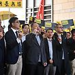 (L-R) Pro-democracy lawmaker Tanya Chan, baptist minister Chu Yiu-ming, sociology professor Chan Kin-man, law professor Benny Tai, former Democratic Party lawmaker Lee Wing-tat, Shiu Ka-chun and League of Social Democrats vice-chairman Raphael Wong chant before entering the West Kowloon Magistrates Court in Hong Kong on April 9, 2019, to find out if they face jail for their involvement in the 2014 Umbrella Movement protests. - They are among nine activists facing rarely used colonial-era public nuisance charges for their participation in the 2014 protests calling for free elections for the city's leader. (Photo by Anthony WALLACE / AFP)
