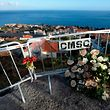 Picture shows flowers in the place where a tourist bus crashed on April 17, 2019 killing 29 in Canico, on April 18, 2019 on the Portuguese island of Madeira. - The Portuguese island of Madeira today began three days of mourning after 29 German tourists died after their bus spun off the road and tumbled down a slope before crashing into a house. (Photo by MIGUEL RIOPA / AFP)