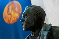 A bust of Alfred Nobel is pictured prior to the announcement of the winners of the 2020 Nobel Prize in Physiology or Medicine at the Karolinska Institute in Stockholm, Sweden, on October 5, 2020. (Photo by Jonathan NACKSTRAND / AFP)