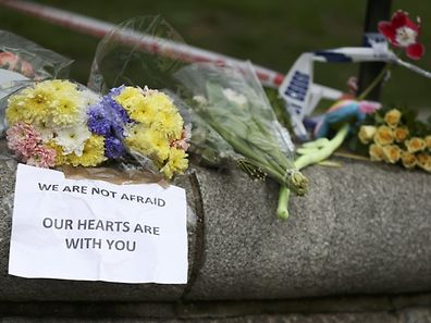 Flowers and messages are left near the scene of an attack by a man driving a car and weilding a knife left five people dead and dozens injured, in London, Britain, March 23, 2017. REUTERS/Neil Hall