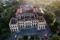 Drone view of Rio de Janeiro's treasured National Museum, one of Brazil's oldest, on September 3, 2018, a day after a massive fire ripped through the building. - The majestic edifice stood engulfed in flames as plumes of smoke shot into the night sky, while firefighters battled to control the blaze that erupted around 2230 GMT. Five hours later they had managed to smother much of the inferno that had torn through hundreds of rooms, but were still working to extinguish it completely, according to an AFP photographer at the scene. (Photo by Mauro Pimentel / AFP)