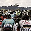 A media helicopter flies over the pack riding during the 178 km tenth stage of the 104th edition of the Tour de France cycling race on July 11, 2017 between Perigueux and Bergerac. / AFP PHOTO / Jeff PACHOUD
