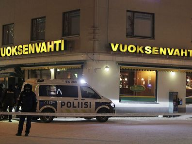 Police guards the area were three people were killed in a shooting incident at a restaurant in Imatra, eastern Finland