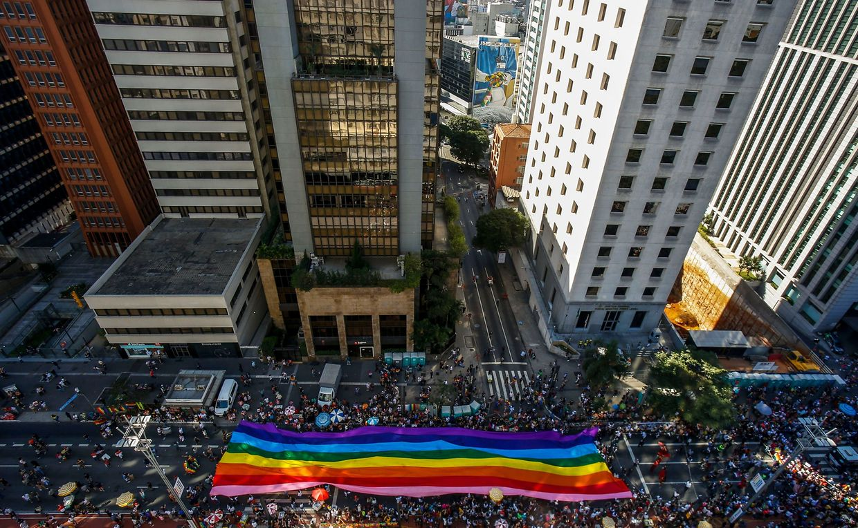 """Aerial view of the 23rd Gay Pride Parade, which theme is """"50 years of Stonewall"""", in Sao Paulo, Brazil on June 23, 2019. (Photo by Miguel SCHINCARIOL / AFP)"""