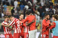 Atletico's players celebrate their win during the Spanish Super Cup semi final between Barcelona and Atletico Madrid on January 9, 2020, at the King Abdullah Sport City in the Saudi Arabian port city of Jeddah. - The winner will face Real Madrid in the final on January 12. (Photo by FAYEZ NURELDINE / AFP)