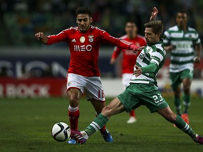 Sporting's player Adrien Silva (R) vies for the ball against Salvio of  Benfica during their Portuguese First League soccer match held at Alvalade Stadium in Lisbon, Portugal, 08 February 2015. JOSE SENA GOULAO/LUSA