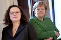 (FILES) In this file photo taken on January 10, 2019, German Chancellor Angela Merkel (R) and the leader of the Social Democratic Party (SPD) Andrea Nahles attend the New Year's reception of the German President at the Bellevue palace in Berlin. - The leader of Chancellor Angela Merkel's junior coalition partner, the SPD, resigned Sunday, June 2, 2019 from her party's top jobs, raising the possibility that Germany's embattled government could collapse. Andrea Nahles, who heads the centre-left Social Democratic Party (SPD), has come under intense pressure after voters handed the party its worst European election results a week ago. (Photo by Britta Pedersen / dpa / AFP) / Germany OUT