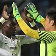 Metz' Senegalese defender Fallou Diagne (L) celebrates with his teammate Japanese goalkeeper Eiji Kawashima at the end of the French L1 Football match between Rennes (Stade Rennais FC) and Metz (FC), on April 14, 2018, at the Roazhon Park, in Rennes, western France. Metz won 2-1. / AFP PHOTO / Jean-Francois MONIER