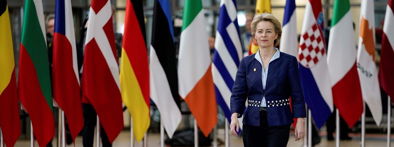 """(FILES) In this file photo taken on December 12, 2019 President of the European Commission Ursula von der Leyen arrives for a European Union Summit at the Europa building in Brussels. - The EU commission chief has defended the slower Covid-19 vaccine rollout in the bloc as a """"good decision"""", saying the European Union would not put the safety of citizens at risk, in an interview published on February 2, 2021. (Photo by Kenzo TRIBOUILLARD / AFP)"""