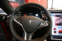 (FILES) In this file photo the inside of a Tesla vehicle is viewed as it sits parked in a Tesla showroom and service center in Red Hook, Brooklyn on July 5, 2016 in New York City. - US safety officials opened a preliminary investigation into Tesla's Autopilot after identifying 11 crashes involving the driver assistance system, officials said on August 16, 2021. The incidents dating back to 2018 included one fatal crash and seven that resulted in injuries, according to the National Highway Traffic Safety Administration. (Photo by SPENCER PLATT / GETTY IMAGES NORTH AMERICA / AFP)