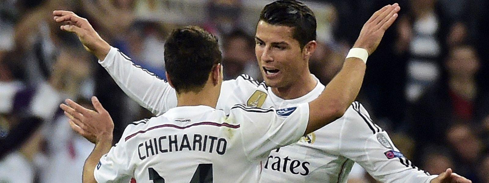 """Cristiano Ronaldo e Javier Hernandez comemoram o golo dos """"merengues"""""""