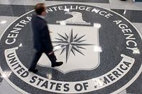 (FILES) This file photo taken on August 13, 2008 shows a man walking over the seal of the Central Intelligence Agency (CIA) in the lobby of CIA Headquarters in Langley, Virginia. The CIA can turn your TV into a listening device, bypass popular encryption apps, and possibly control your car, according to a trove of alleged documents from the US spy agency released on March 7, 2017 by WikiLeaks. The group posted nearly 9,000 documents it said were leaked from the Central Intelligence Agency, in what it described as the largest-ever publication of secret intelligence materials.  / AFP PHOTO / AFP FILES / SAUL LOEB