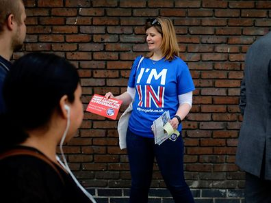 A woman hands out leaflets campaigning to stay in Europe for the BREXIT vote in London